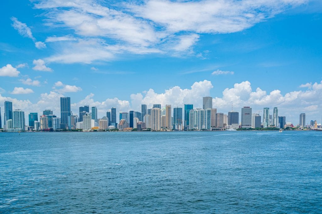 Skyline of downtown Miami as seen from a boat in the bay--plenty of Miami quotes cover how remarkable this city is!