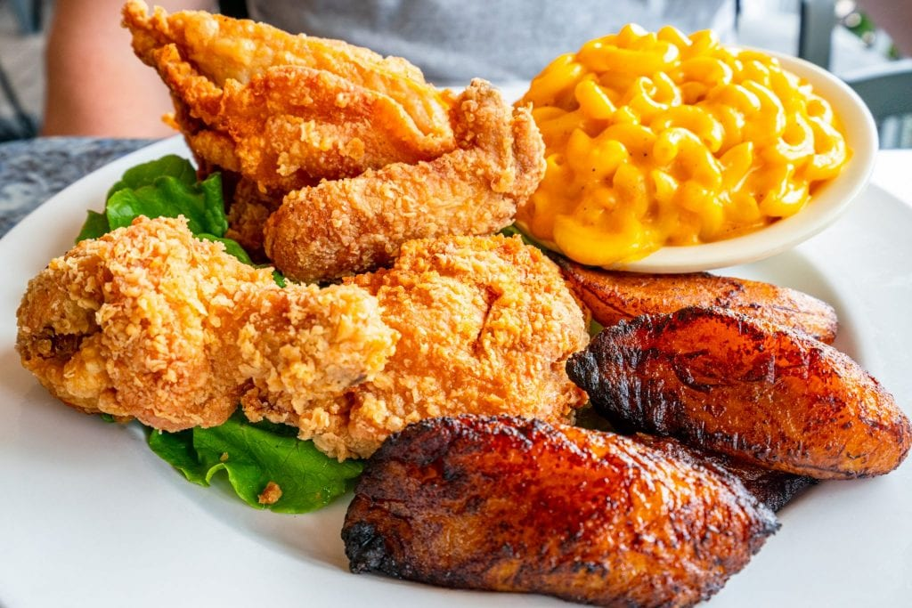 Plate of fried chicken, sweet plantains, and macaroni and cheese, as served at 11th Street Diner in Miami Beach.
