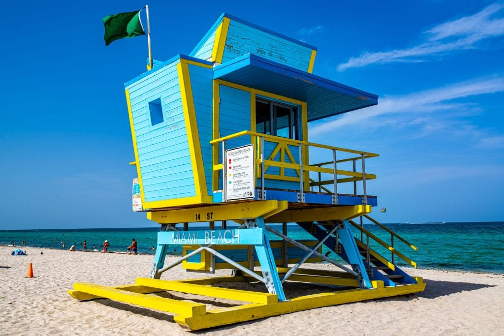 Blue and yellor art deco lifeguard stand on South Beach in Miami, which is a must-see beach for your USA bucket list!