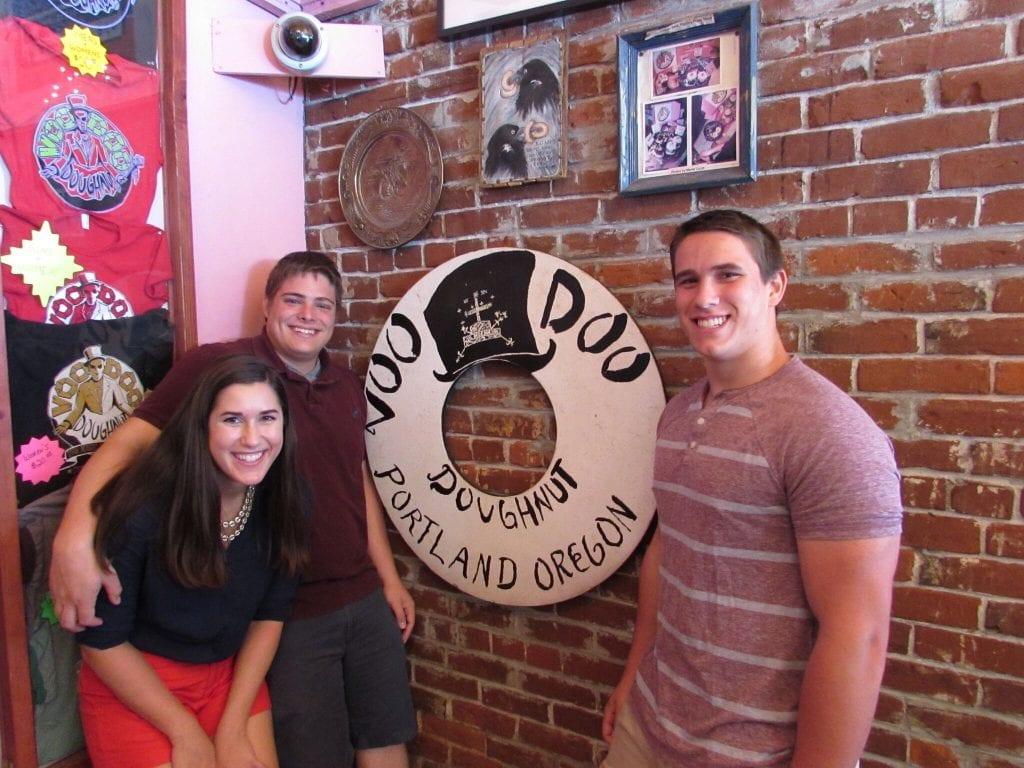 Kate Storm Jeremy Storm and Jack Wodarski in Voodoo Donuts in 2014 in Portland Oregon