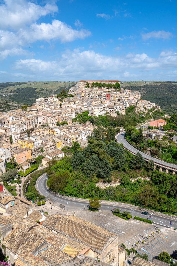 Winding roads in Sicily with Ragusa Ilba visible in the background, a must-see during 10 days in Sicily