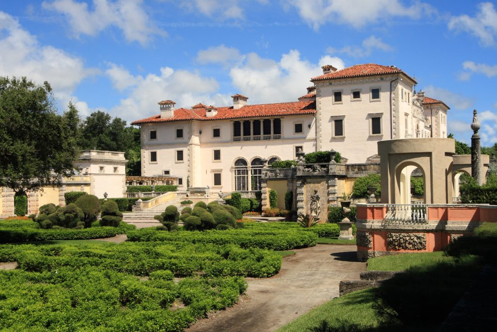 vizcaya mansion as seen from the gardens, one of the best things to do over a long weekend in miami florida