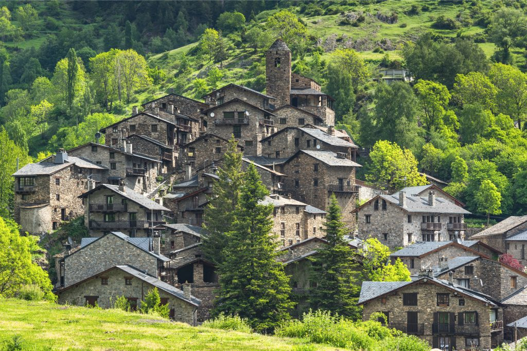 stone village in the hills of andorra, visible on a france road trip itinerary from toulouse to andorra