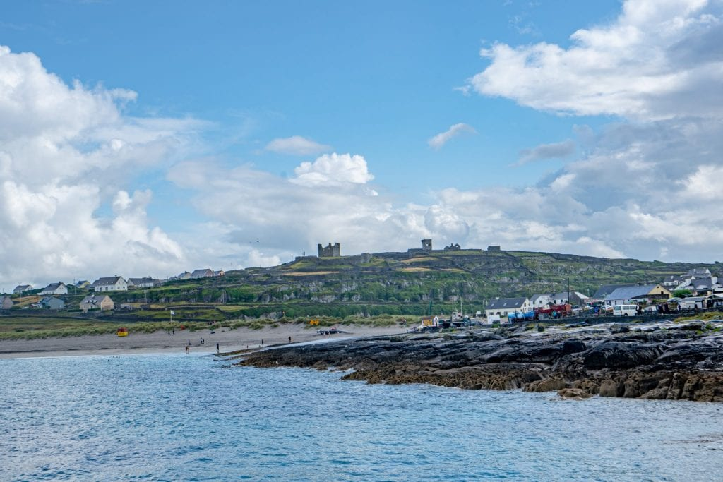 View of Inisheer Island with O'Brien's Castle perched at the top--visiting O'Brien's Castle is one of the best things to do on Inisheer Ireland!