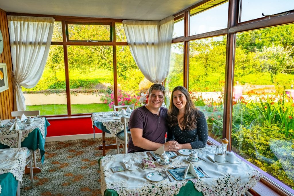 Kate Storm and Jeremy Storm sitting at a breakfast table at a bed and breakfast near Cork Ireland.