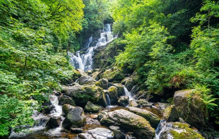 Torc Waterfall in Killarney National Park, a must-see during your 10 day Ireland road trip!