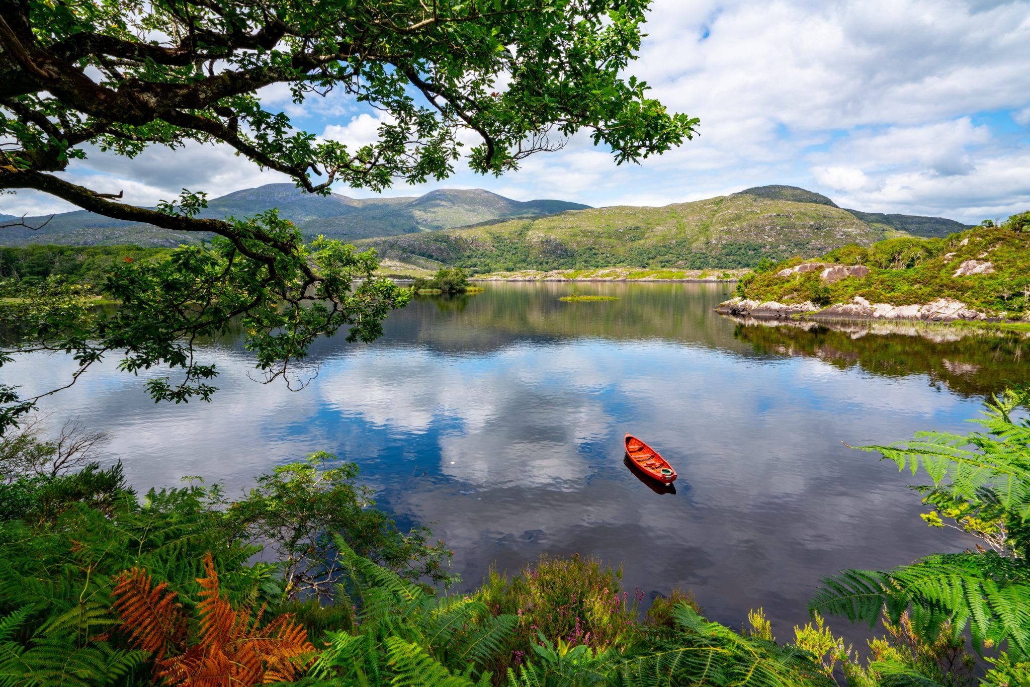 Photo of a rowboat in a lake in Killarney National Park Ireland--definitely be prepared for all weather when putting together your Ireland packing list!