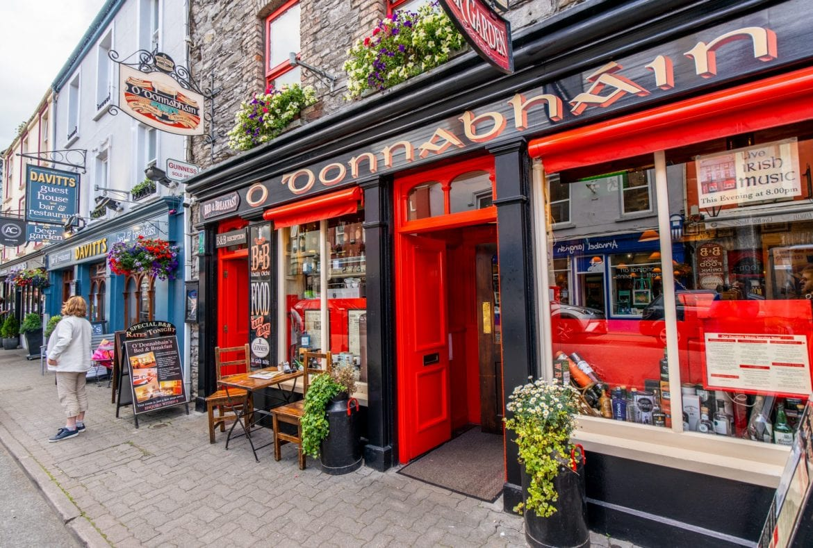 Colorful pub painted red in Kenmare Ireland, one of the prettiest small towns in Ireland