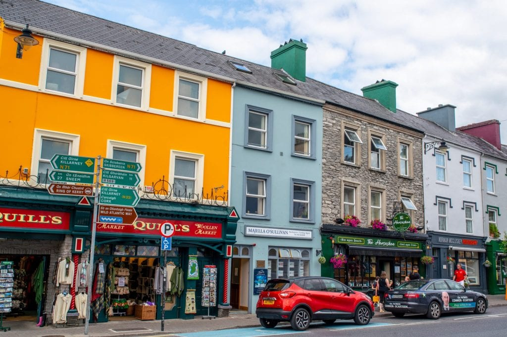 Colorful street in Kenmare Ireland with yellow building toward the left