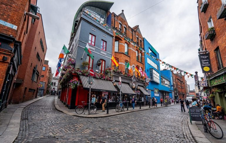 Cobblestone streets surrounding colorful buildings in Dublin Ireland