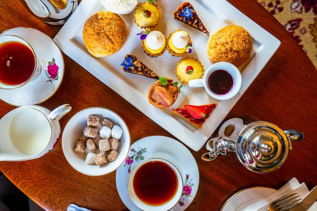 Traditional afternoon tea service shot from above at Belleek Castle--experiences like this are definitely worth keeping in mind when putting together your Ireland travel budget