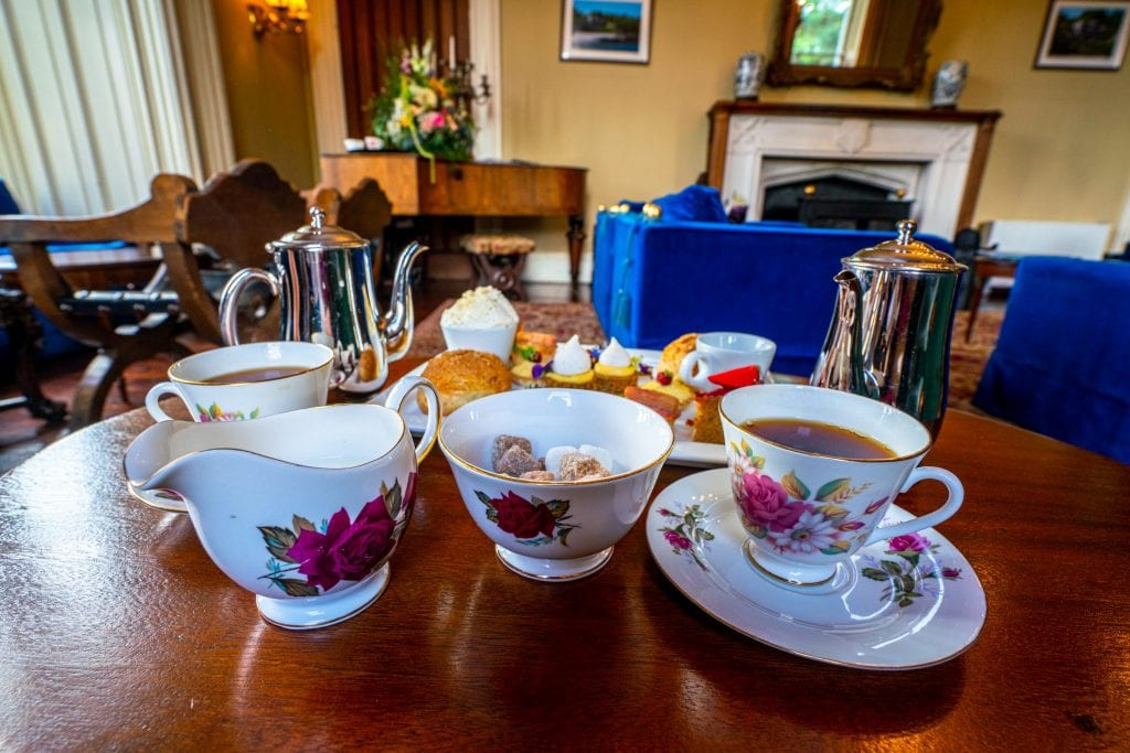 Irish tea set with pink flowers being displayed at Belleek Castle. A beautiful tea set is one of the best Irish souvenirs