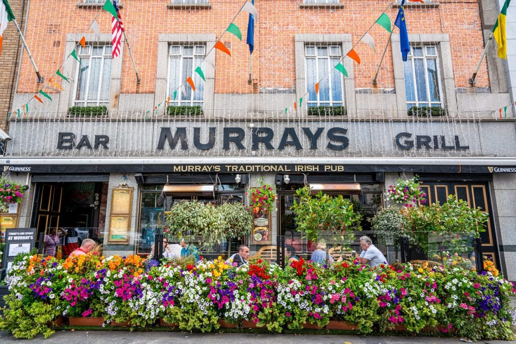 Photo of Murrays Grill in Dublin Ireland with colorful flowers out front
