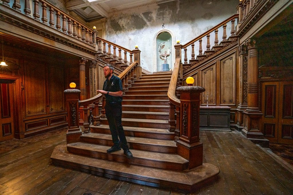 Staircase in Loftus Hall with tour guide standing on it--for independent travelers, this is part of one of the best day trips from Dublin Ireland!
