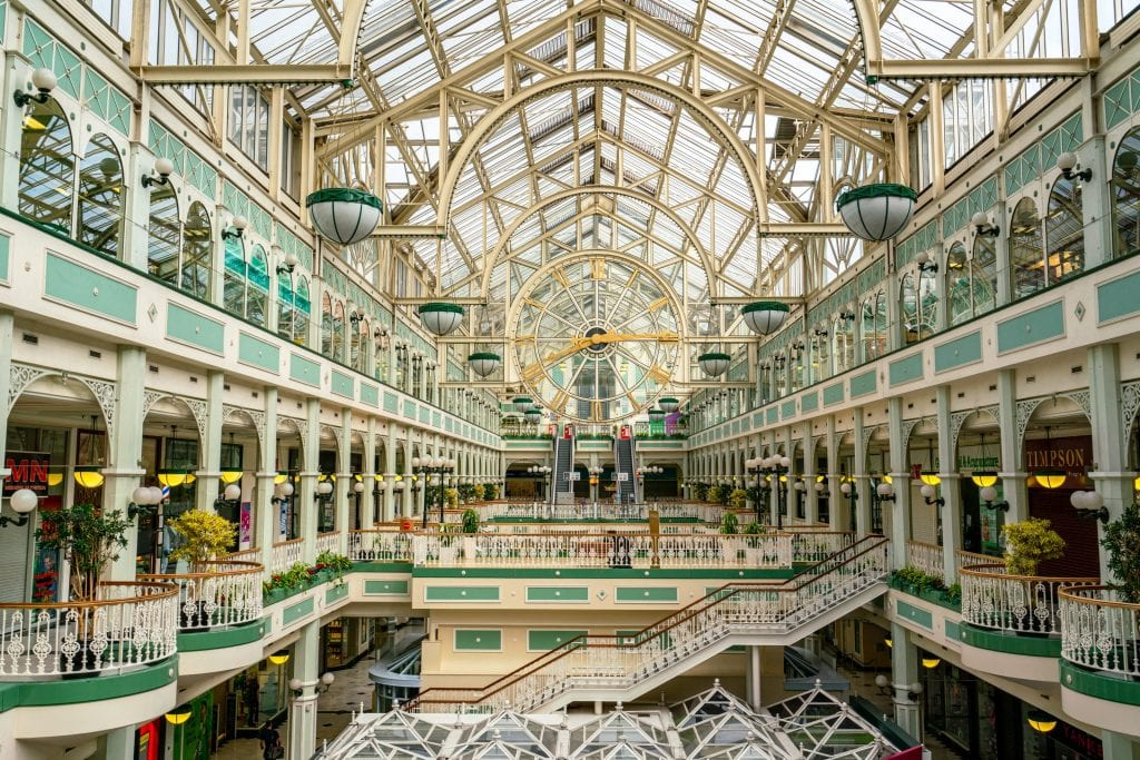 Interior of St Stephen's Green Shopping Centre with clock in the center of the photo