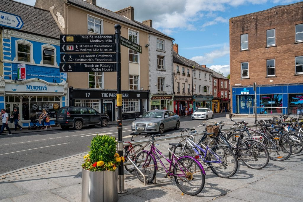Colorful street in Kilkenny Ireland with bikes parked on the righthand side. Kilkenny is among the top day trips from Dublin Ireland