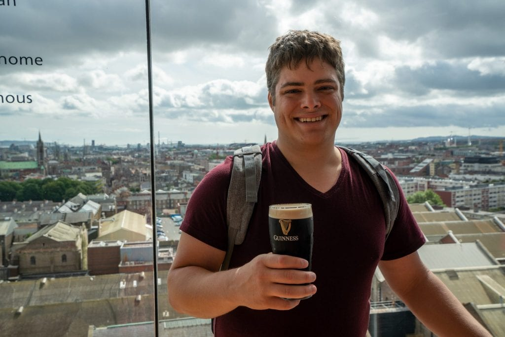Jeremy Storm drinking a Guinness when spending a couple days in Dublin Ireland
