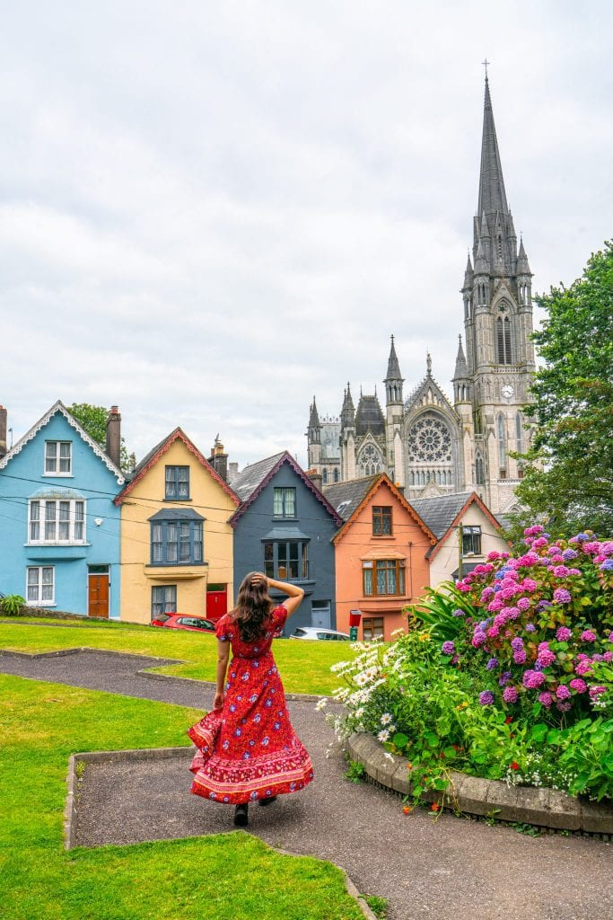 Kate Storm in Cobh Ireland wearing the red dress recommended on this packing list for Ireland