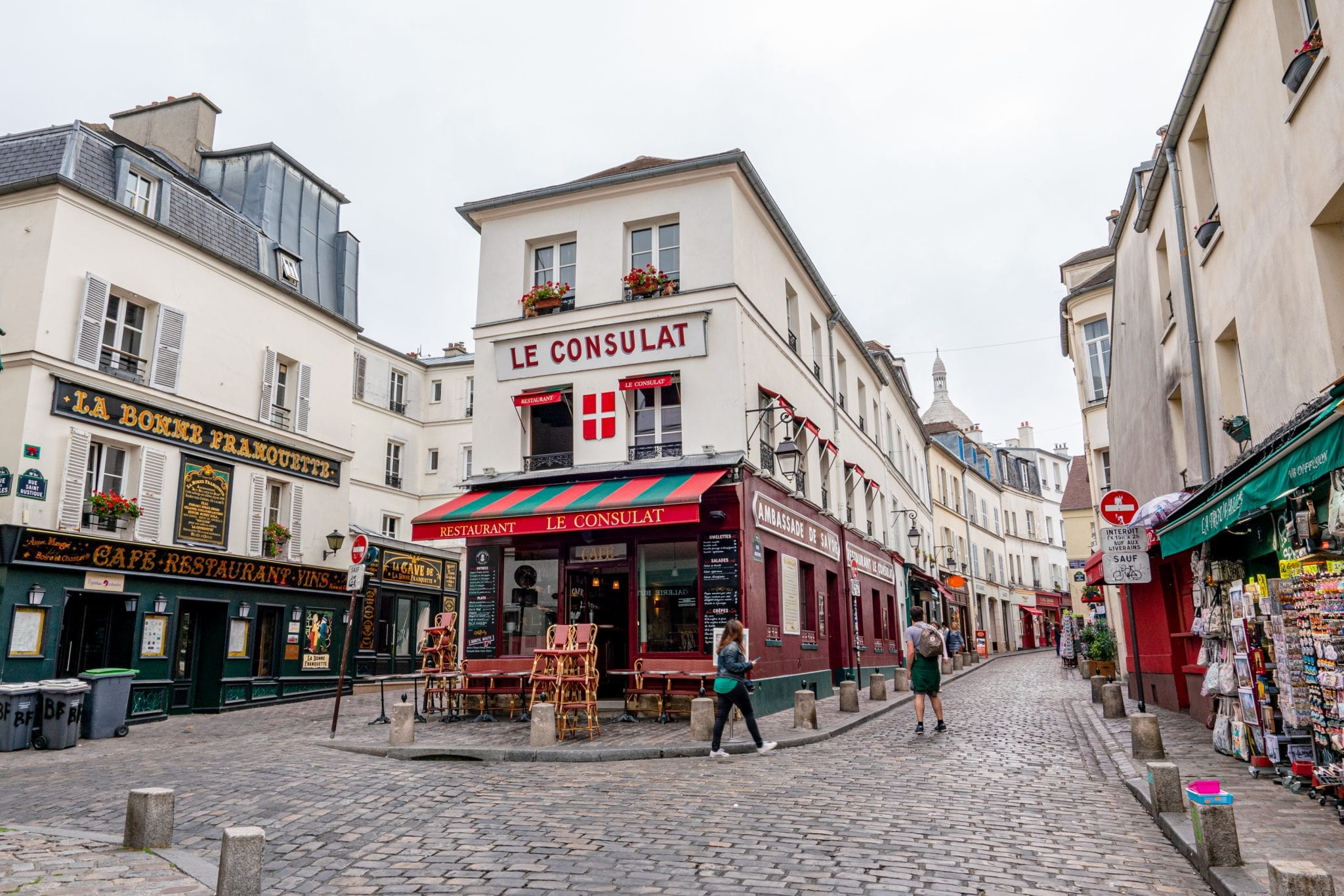 Le Consulat Cafe in Montmartre with no people in front of it, one of the most instagrammable places in Paris