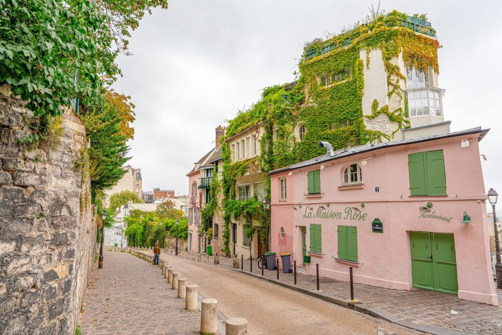 La Maison Rose on Montmartre next to an empty street--definitely a pretty stop along the way during your 2 days in Paris France!