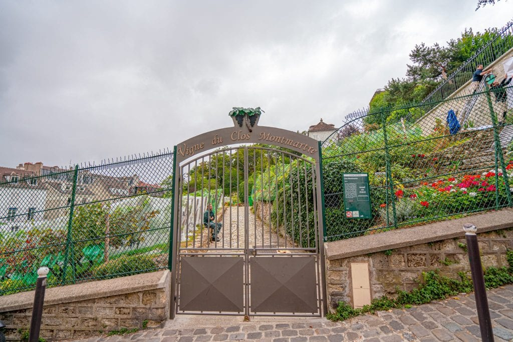 Locked gate of Le Clos Montmartre, the secret Paris vineyard that's worth tracking down in Montmartre.