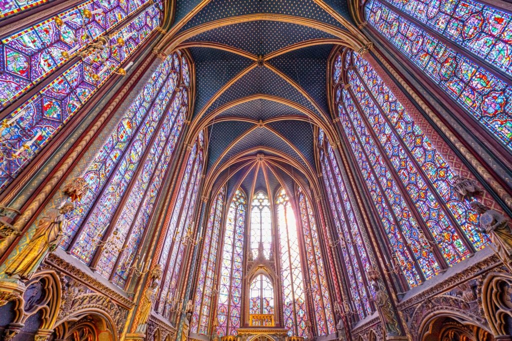Interior of the stained glass of Sainte-Chapelle when looking up from the altar, one of the prettiest places to photograph in Paris France