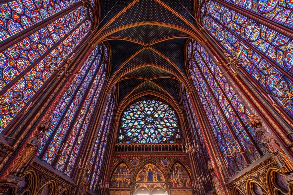 Stained Glass of Sainte-Chapelle with rear window of stained glass in the center--this chapel belongs on any Paris itinerary, and you should definitely visit during your Paris weekend trip!