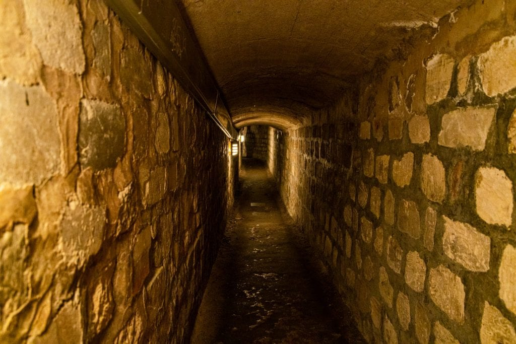 Narrow passage in the Paris catacombs
