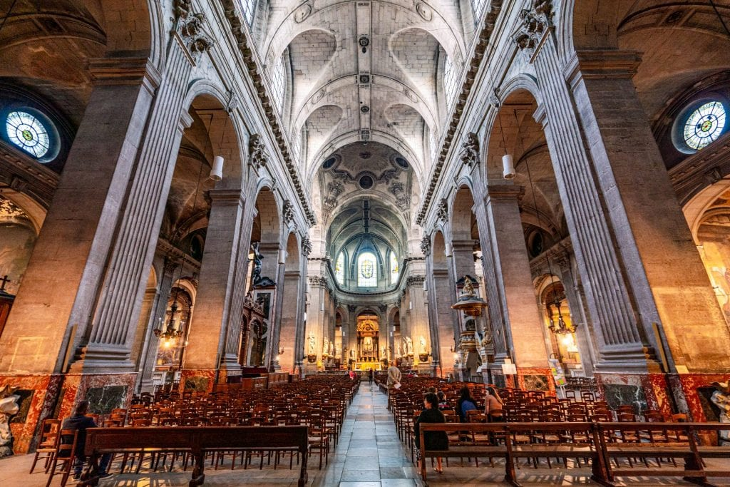 Interior of Church of Saint Sulpice in Paris--when trying to learn how much a trip to Paris costs, keep in mind that many gorgeous spots like this are free to visit!