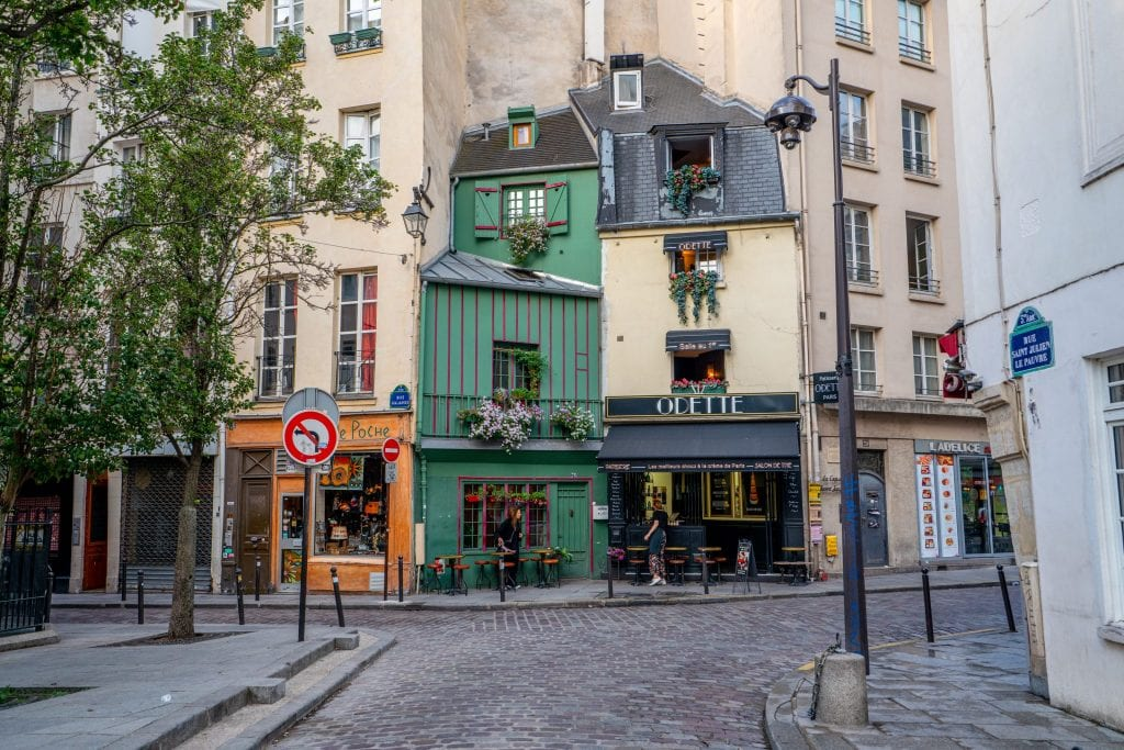 Odette Cafe in Paris France with an empty cobblestone street in front of it--not a bad place to grab a coffee during your 2 days in Paris France!