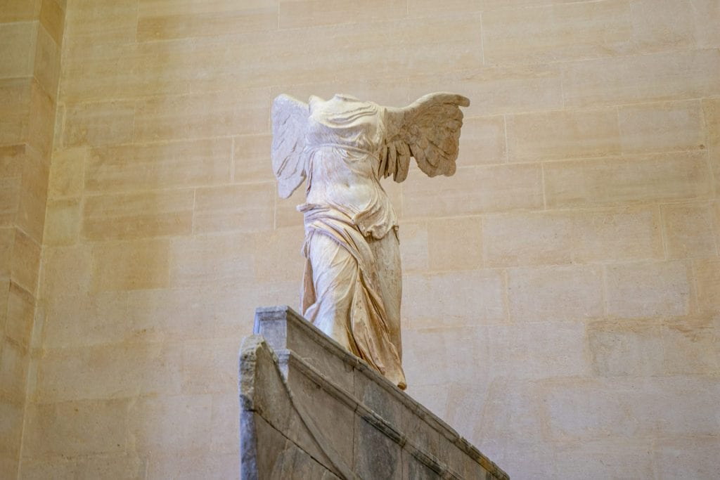 Winged Victory Statue in the Louvre--when calculating your trip to Paris cost, definitely try to budget to see the Louvre!