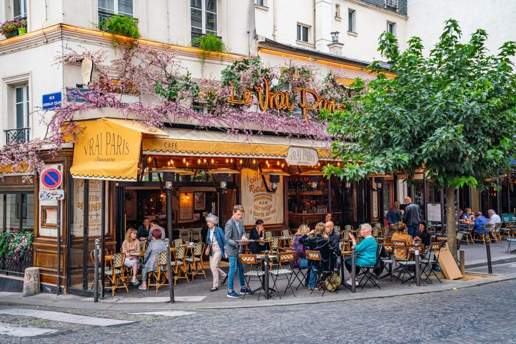 Photo of a colorful cafe in Paris France--any weekend in Paris trip will include plenty of time in cafes!