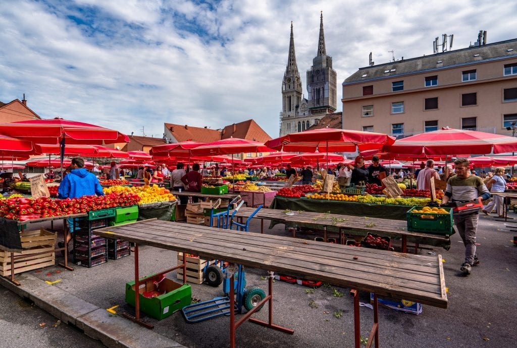 Photo of Dolac Market shaded by red umbrellas, a must-see on a one day in Zagreb itinerary