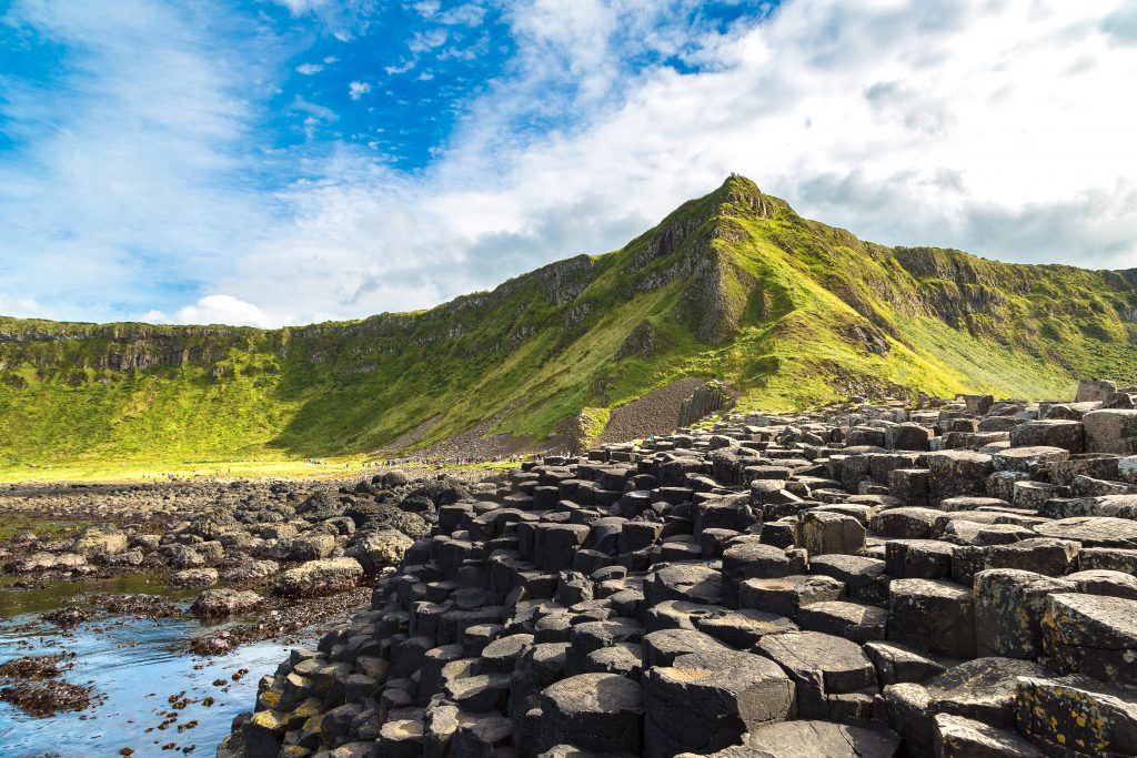 giants causeway in northern ireland on a sunny day looking toward the island