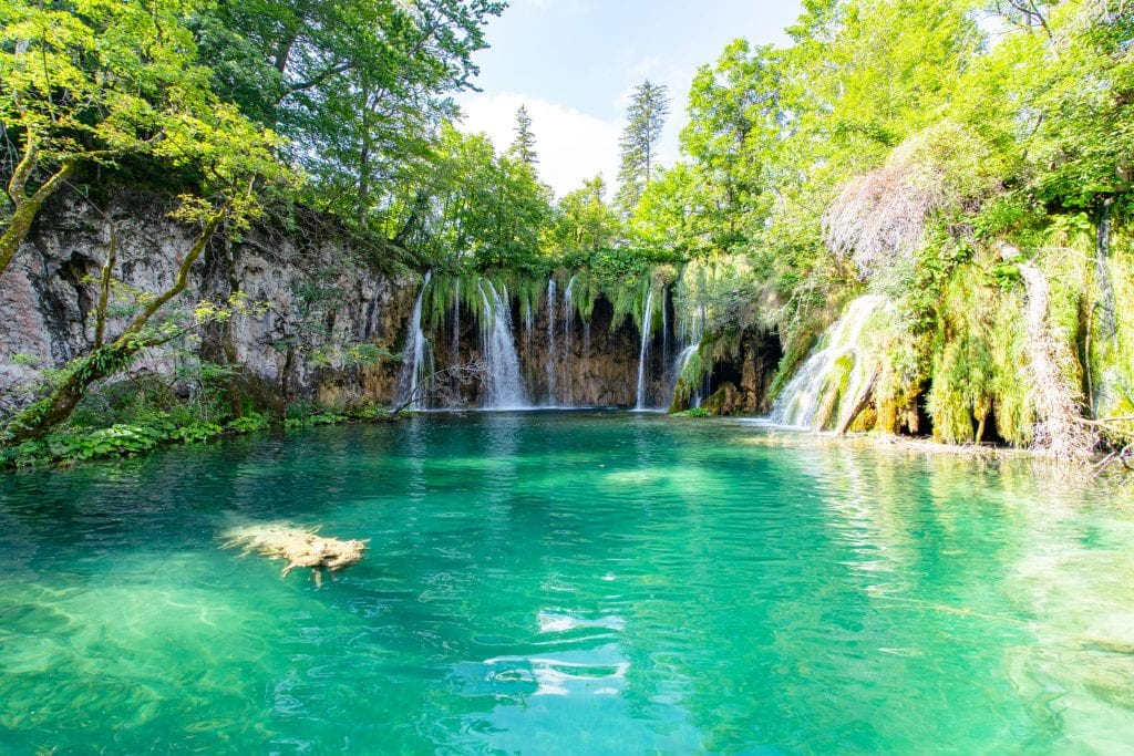 Turquoise lake with small waterfalls as seen in Plitvice Lakes National Park Croatia, an important part of any 10 day Croatia itinerary!