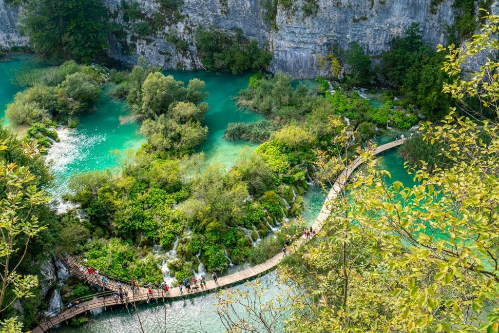 View of the ramps crossing Plitvice Lake National Park in Croatia with turquoise water on either side as seen from above
