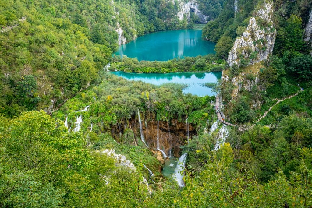 Plitvice Lakes National Park Croatia postcard view from above with lakes in the center surrounded by trees, a must-see on your 10 day trip to Croatia!
