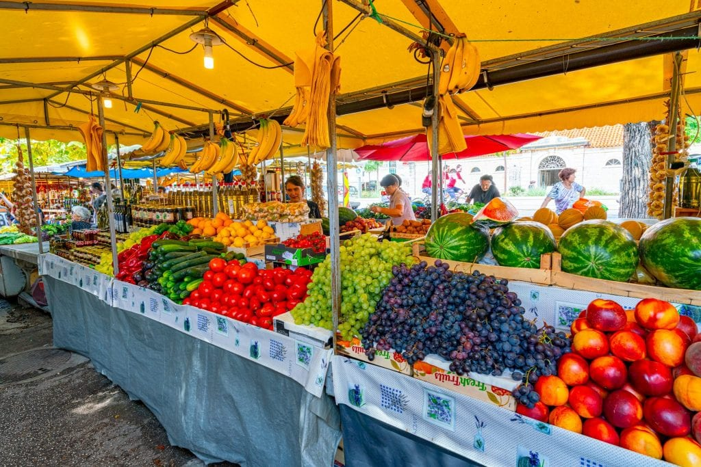 produce for sale at a market in croatia: is croatia expensive? the fruit definitely isn't.