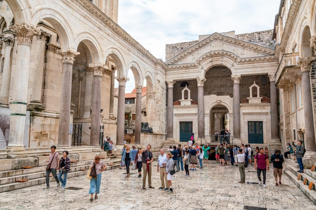 Interior courtyard of Diocletian's Palace in Split Croatia with tourists in the center