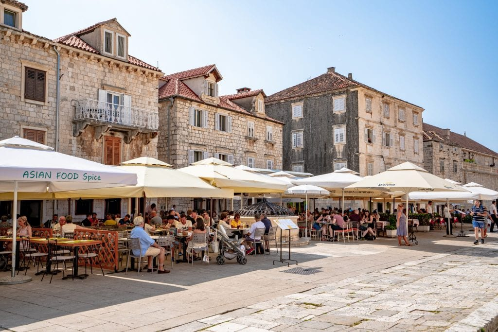 Restaurants lining a stone street in the main square of Hvar Croatia
