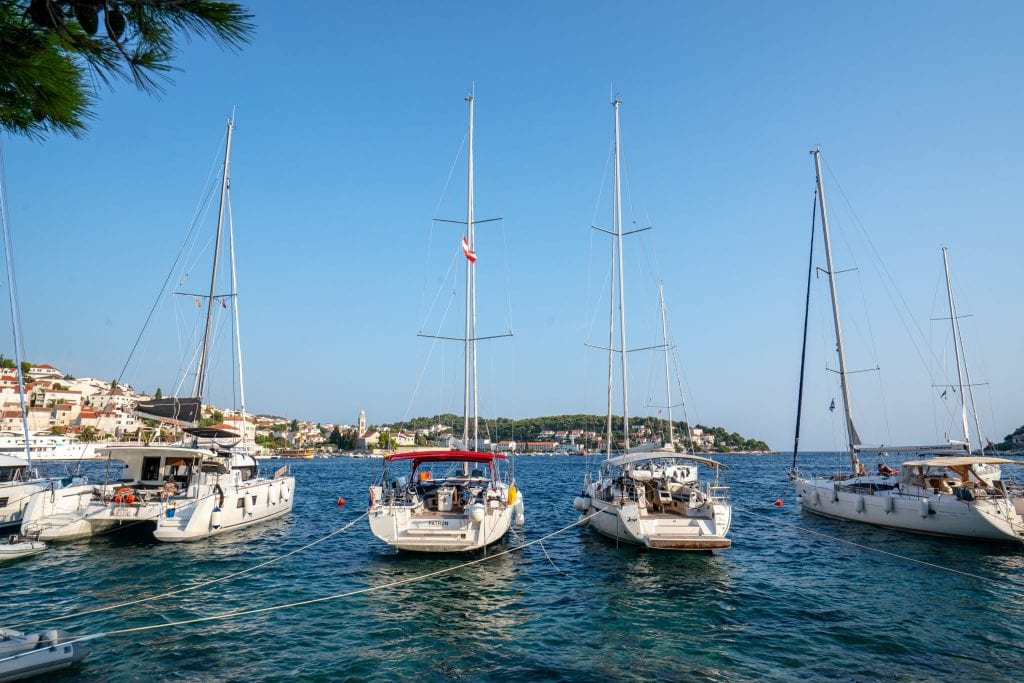 Four sailboats parked near Hvar Croatia--walking around the waterfront is one of the best things to do in Hvar Croatia!