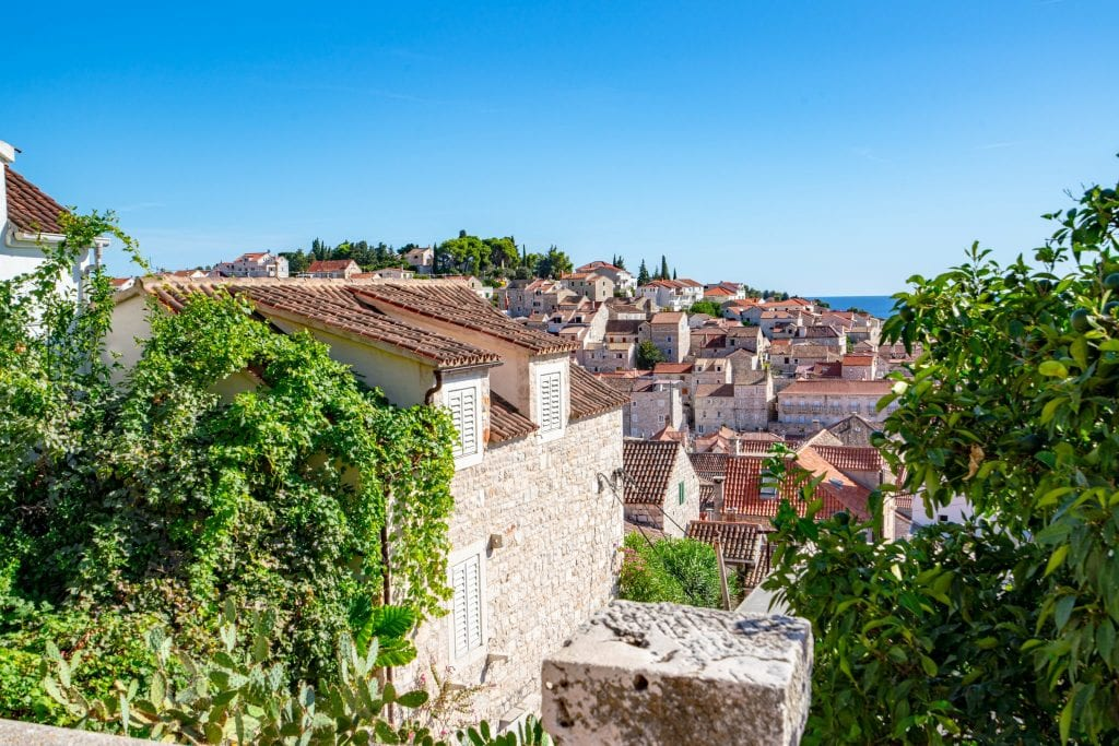 Photo of rooftops near the top of Hvar Croatia--seeking out views from above is one of the most fun things to do in Hvar Croatia