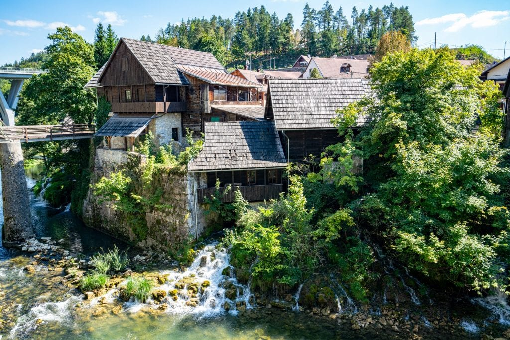 traditional wooden home of rastoke croatia with waterfall under it, one of the most beautiful places to visit in croatia