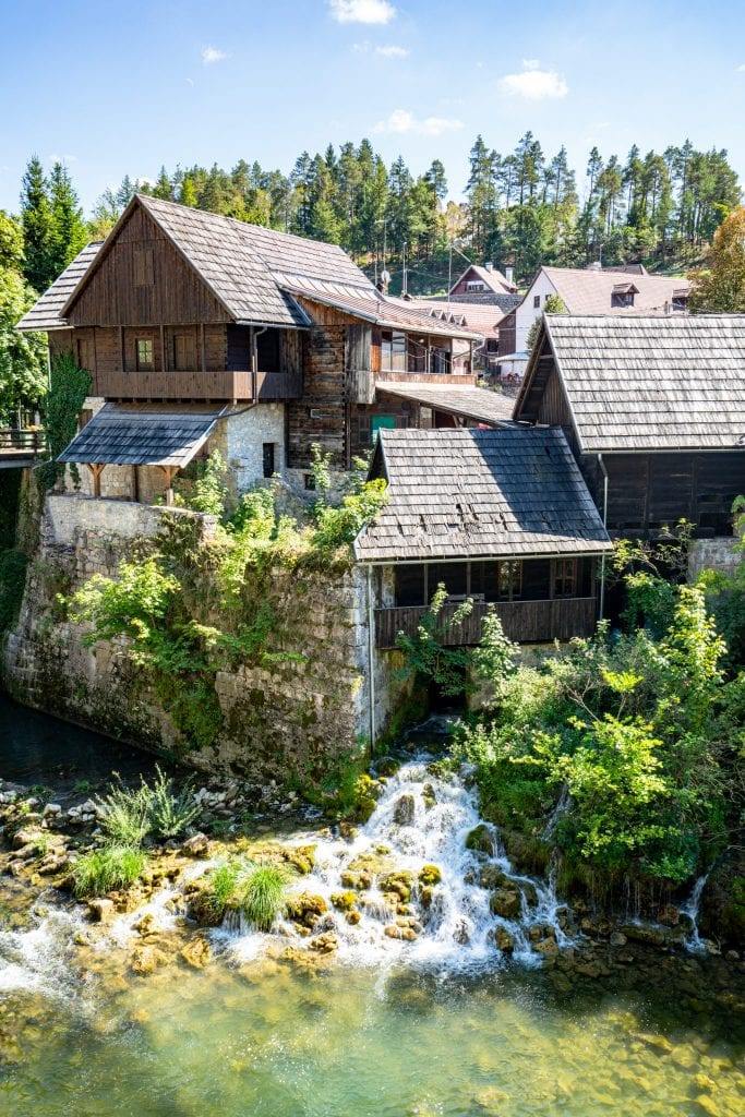 Rastoke Croatia wooden house with old mill in front and waterfalls running under it