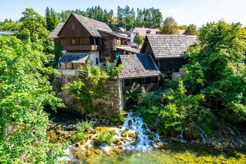 Mill in Rastoke Croatia with a waterfall underneath it, an unforgettable sight on this Croatia in 10 days Croatia itinerary