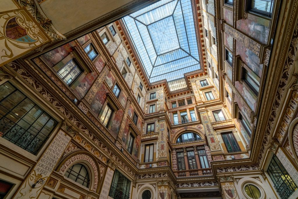 Photo of Galleria Sciarra Rome looking up, showing the vaulted glass ceiling in the center
