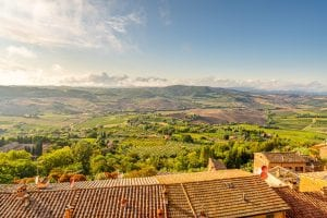 Tuscan countryside as seen from Montepulciano, with the countyside bathed in golden light--this Tuscany travel blog post will cover everything you need to know about finding spots like this during your Tuscany road trip!