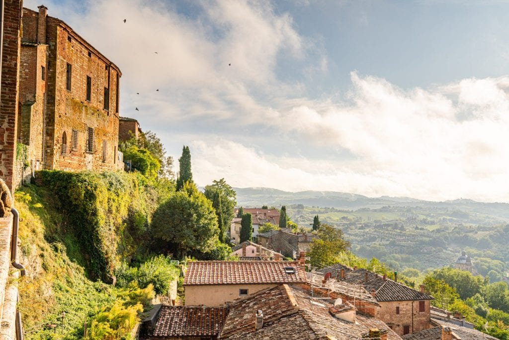 View of the Tuscan countryside from Montepulciano with the village on the left, one of the best stops when driving from Rome to Florence road trip