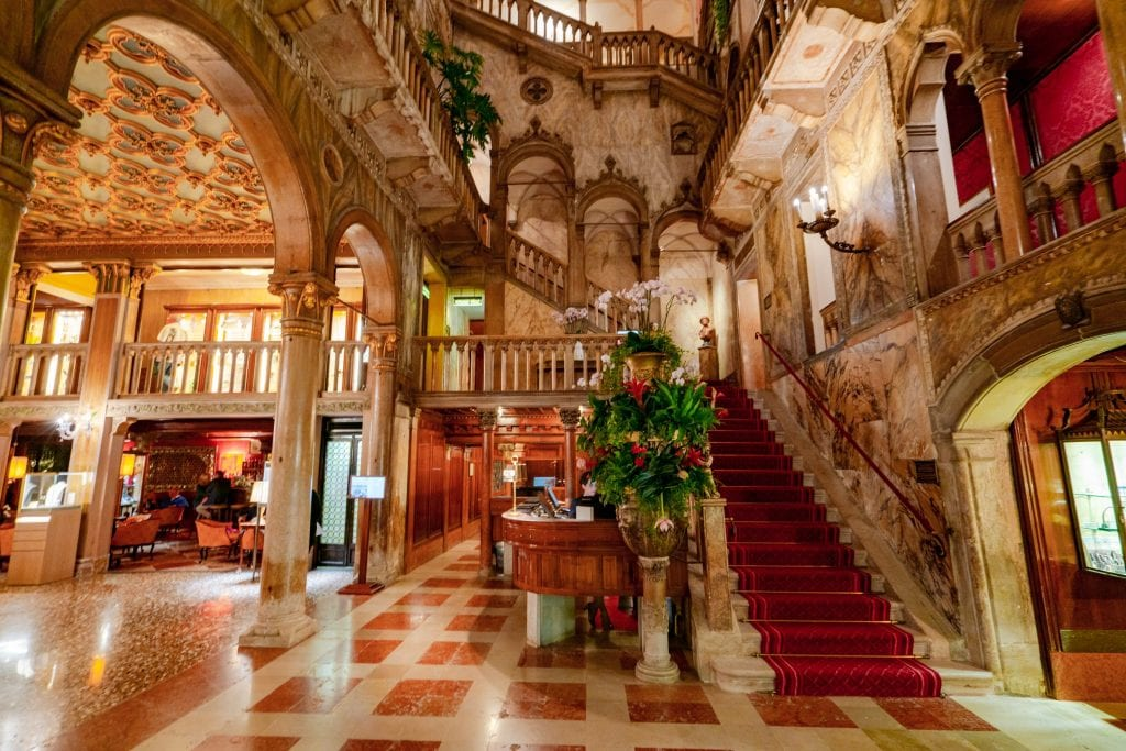Lobby and staircase of Hotel Danieli in Venice--the perfect luxury hotel when deciding where to stay in Venice!