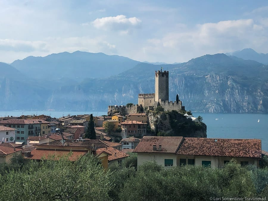 Village of Malcesine as seen from above with Lake Garda in the background, one of the loveliest small towns in Italy